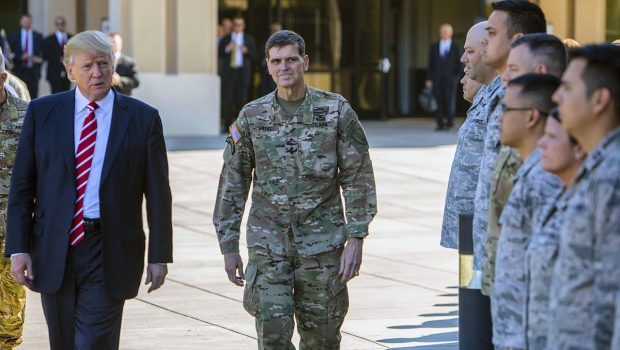 CENTCOM Commander General Joseph Votel (C) inspects troops with President Donald Trump (L) during Trump's February visit to CENTCOM HQ at MacDill Air Force Base