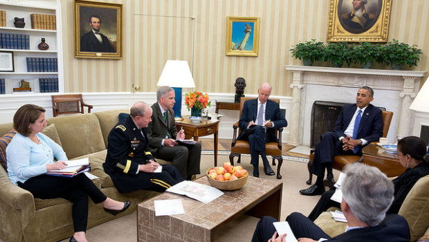 President Barack Obama convenes an Oval Office meeting with his national security team to discuss the situation in Iraq, June 13, 2014.