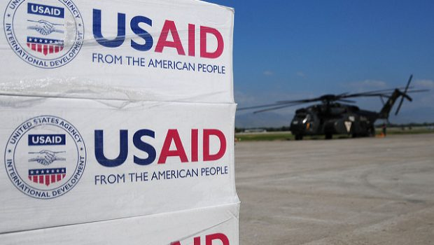 100117-N-6247V-083 PORT-AU-PRINCE, Haiti (Jan. 17, 2010) Pallets of food, water and supplies sit on the flight line at the airport as a MH-53E helicopter from Helicopter Mine Countermeasures Squadron 14 awaits to be on loaded with supplies. Carl Vinson and Carrier Air Wing 17 are conducting humanitarian and disaster relief operations as part of Operation Unified Response after a 7.0 magnitude earthquake caused severe damage in Haiti Jan. 12. (U.S. Navy photo by Mass Communication Specialist 2nd Class Candice Villarreal/Released)