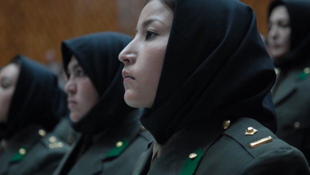 KABUL, Afghanistan -- Women from the first graduating class of the Afghan National Army Female Officer Candidate School stand for the playing of the national anthem during their graduation ceremony, Sept. 23, 2010. Twenty-nine Afghan women completed 20 weeks of training, which included 8 weeks of basic training and 12 weeks of advanced training in logistics and finance. (U.S. Air Force photo/Staff Sgt. Laura R. McFarlane/Released)