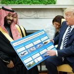 Donald Trump displays a chart of U.S. arms sales to Saudi Arabia to Crown Prince Mohammed bin Salman