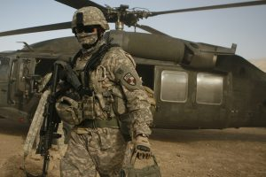 U.S. soldier exits a UH-60 Blackhawk helicopter (U.S. Marine photo/Sgt. Brian Kester).