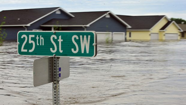 Ten feet of water flood nearly 20 percent of the neighborhood throughout the city of Minot, N.D., leaving more than 4,000 homes inundated by flooding, June 25. With the Souris River expected to crest, city official scramble to implement a recovery strategy hoping to endure the high water preventing the loss of thousands of homes already damaged by flooding. At eight feet above major flood stage, the water appears to be leveling off.