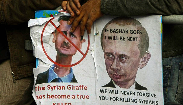 A poster at a demonstration against Bashar al-Assad and Vladimir Putin, courtesy of Freedom House via Flickr