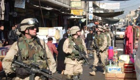 Soldiers from Bravo Company 2-325 Parachute Infantry Regiment (PIR), attached to Task Force Tacoma walk through a market in the Al Sudeek district during a dismounted patrol in Mosul, Iraq on January 9, 2005. Bravo Co. 2-235 PIR is in Iraq in support of Operation Iraqi Freedom. U.S. Army photo by Spc. Adam Sanders (RELEASED)