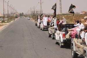Sinai militia carrying al-Qaeda flags head for a funeral of killed militants (Hisham Allam/IPS)
