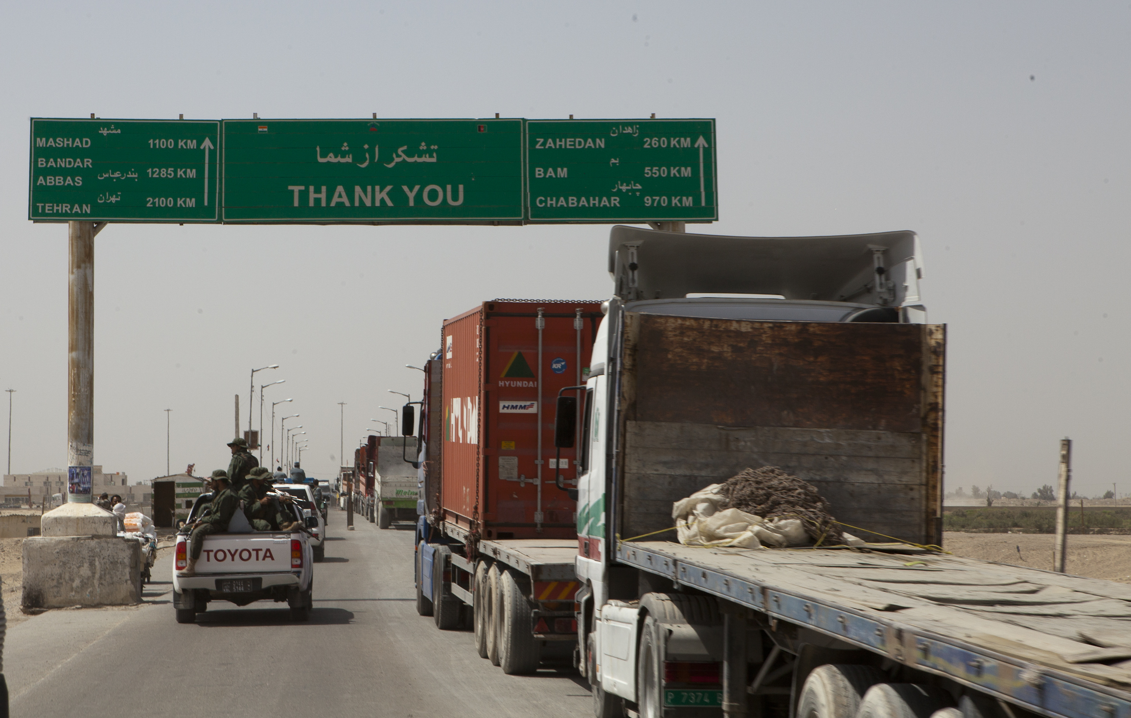 Trucks wait to cross the Afghanistan-Iran border in Zaranj, Afghanistan, May 10, 2011. The crossing is part of a busy trade route between Central Asia and the Middle East. (U.S. Marine Corps photo by Sgt. Mallory S. VanderSchans/Released)
