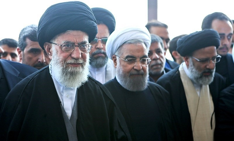 Ali_Khamenei_and_Hassan_Rouhani_in_funeral_of_Abbas_Vaez-Tabasi