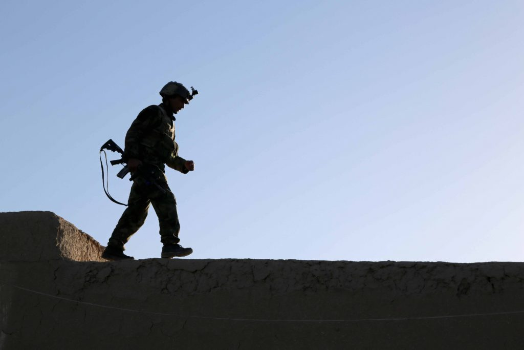 an_afghan_national_army_commando_with_the_1st_company_6th_special_operations_kandak_secures_a_rooftop_during_an_operation_in_baraki_barak_district_logar_province_afghanistan_may_1_2013_130501-a-s