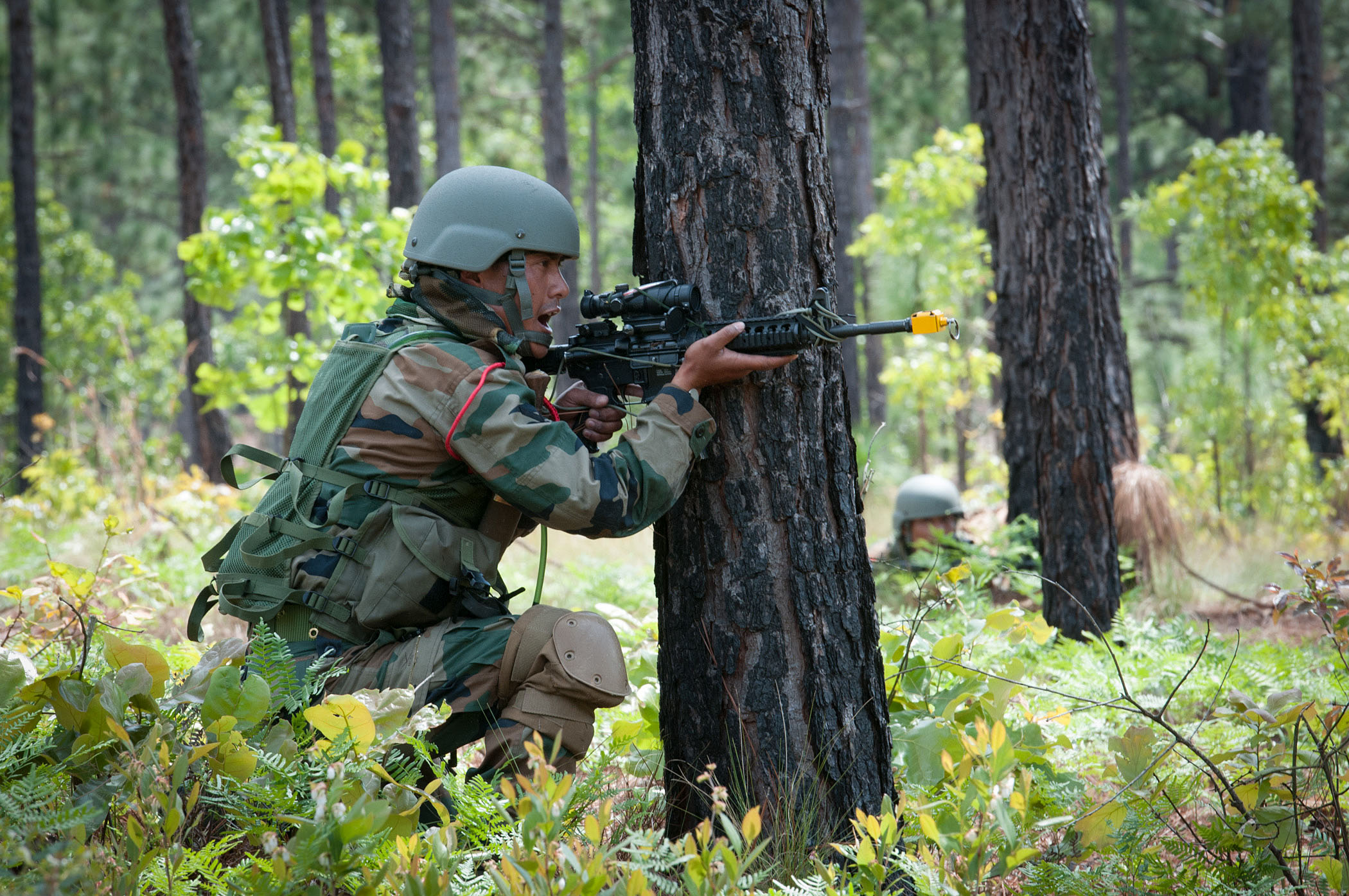 An Indian Army soldier with the 99th Mountain Brigade fires at role-playing insurgents during bilateral training with paratroopers of the 82nd Airborne Division's 1st Brigade Combat Team May 8, 2013, at Fort Bragg, N.C.  The soldiers were participating in Yudh Abhyas, an annual training event between the Indian Army and United States Army Pacific to improve the ability of the forces involved to respond to a wide range of contingencies.  (U.S. Army photo by Sgt. Michael J. MacLeod)
