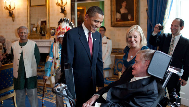 President Barack Obama talks with Stephen Hawking in the Blue Room of the White House before a ceremony presenting him and 15 others the Presidential Medal of Freedom, August 12, 2009.