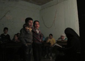 Children singing in underground school in Aleppo, October 2014. Credit: Shelly Kittleson/IPS
