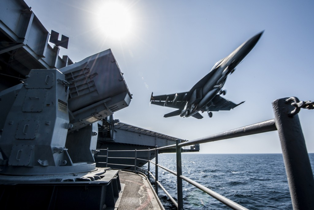 An F/A-18 Super Hornet launches from the flight deck of the Nimitz-class aircraft carrier USS Carl Vinson (CVN 70) as the ship conducts flight operations in the U.S. 5th Fleet area of operations supporting Operation Inherent Resolve. The Carl Vinson Carrier Strike Group is currently deployed to the area supporting maritime security operations, strike operations in Iraq and Syria as directed, and theater security cooperation efforts in the 5th Fleet AOR. (U.S. Navy photo by Mass Communication Specialist 2nd Class Alex King/Released)