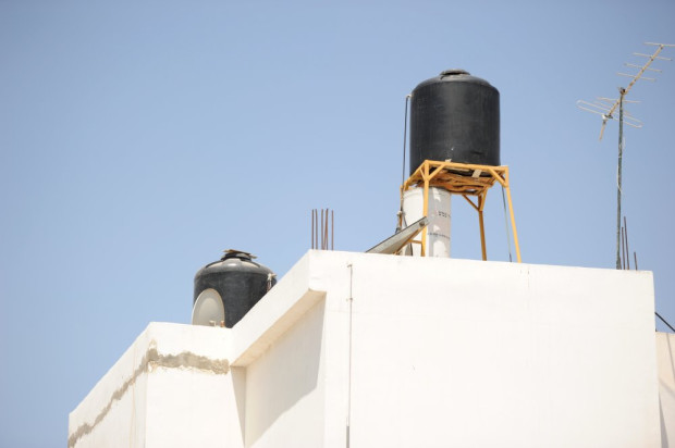 Rooftop water cisterns in Jenin