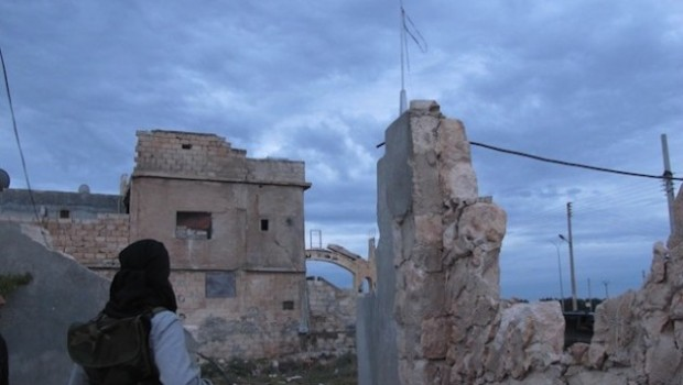 Local-Free-Syrian-Army-member-at-entrance-to-Sarmeen.Shelly-Kittleson-copy-629x472