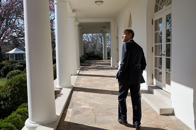 President Barack Obama looks out over the Rose Garden as he walks along the Colonnade of the White House, April 2, 2013. (Official White House Photo by Pete Souza)
