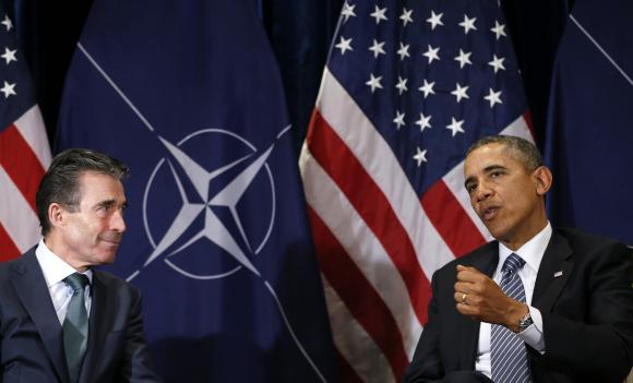 U.S. President Obama meets with NATO Secretary-General Fogh Rasmussen in Brussels