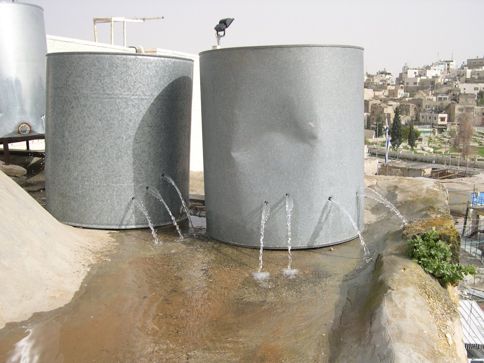 Palestinian_water_tanks_destroyed_by_settlers_in_Hebron