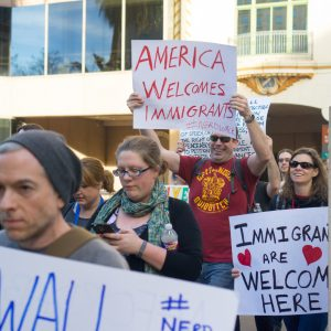 Protest_from_Pax_South_attendees_following_President_Trump's_executive_order_to_decrease_access_to_healthcare_and_a_travel_ban_on_7_Muslim-majority_nations._(31799345443)