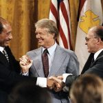 Anwar Sadat, Jimmy Carter, and Menachem Begin (Wikimedia Commons)