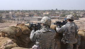 U.S. Army Pfc. Robert Wimegar, left, and Sgt. Troy Bearden, both from Alpha Company, 2nd Battalion, 16th Infantry Regiment, 2nd Brigade Combat Team, 1st Infantry Division, pull security on the rooftop of the District Council Hall in the Mashtal area of East Baghdad, Iraq, March 13, 2007.  (U.S. Army photo by Spc. Davis Pridgen) (Released)