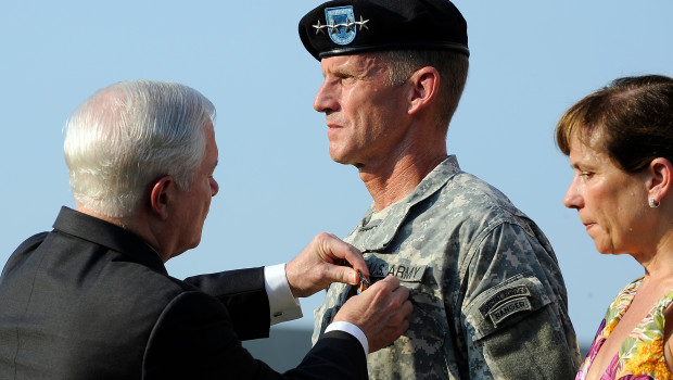 Defense Secretary Robert M. Gates, left, awards the Distinguished Service Medal to Gen. Stanley McChrystal with is wife Annie as he is honored at a retirement ceremony at Fort McNair in Washington, Friday, July 23, 2010. DoD Photo by Air Force Master Sgt. Jerry Morrison(RELEASED)