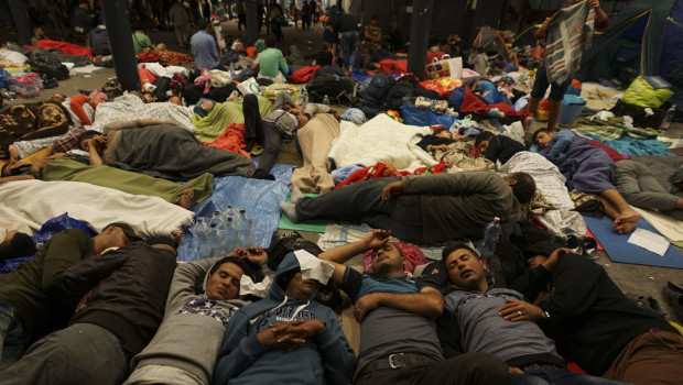 Syrian refugees having rest at the floor of Keleti railway station. Refugee crisis. Budapest, Hungary, Central Europe, 5 September 2015.
