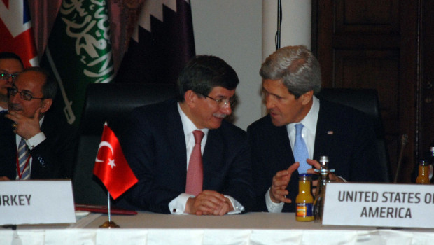 U.S._Secretary_of_State_John_Kerry_speaks_with_Turkish_Foreign_Minister_Ahmet_Davutoglu_before_the_Friends_of_Syria_Core_Group_Ministerial_in_Istanbul,_Turkey_on_April_20,_2013_(Pic_2)