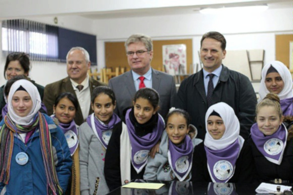 UNRWA Commissioner-General Pierre Krähenbühl with members of the US-supported school parliament at the UNRWA Girls' School in Jalazone refugee camp, West Bank, December 13, 2015. (Department of State).
