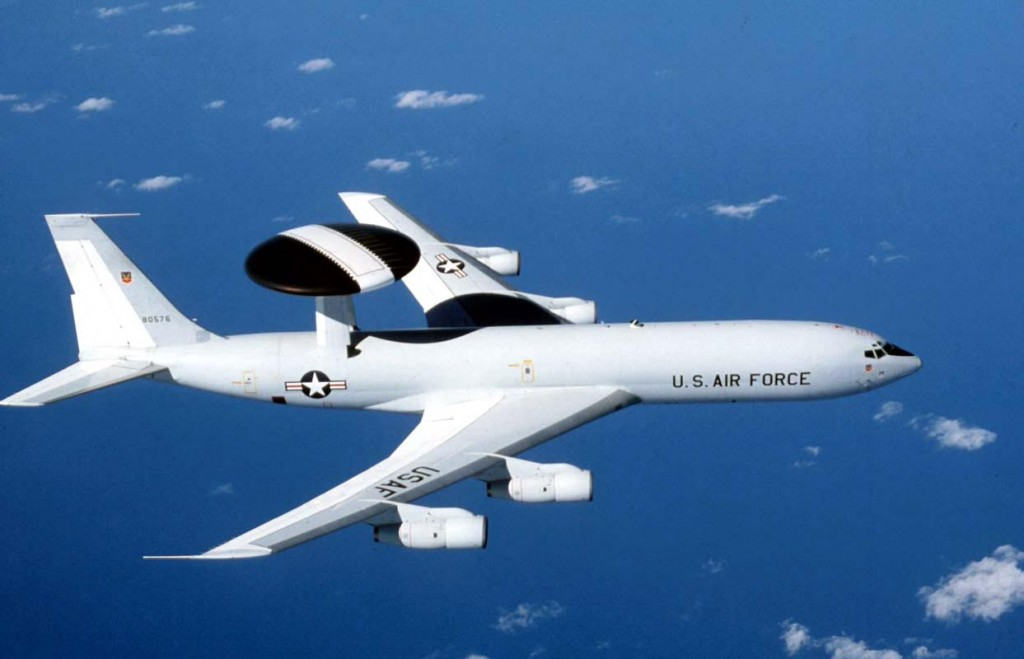 The E-3 Sentry is an airborne warning and control system (AWACS) aircraft that provides all-weather surveillance, command, control and communications needed by commanders of U.S. and NATO air defense forces. As proven in Desert Storm, it is the premier air battle command and control aircraft in the world today. The E-3 Sentry is a modified Boeing 707/320 commercial airframe with a rotating radar dome. The dome is 30 feet (9.1 meters) in diameter, six feet (1.8 meters) thick, and is held 11 feet (3.3 meters) above the fuselage by two struts. It contains a radar subsystem that permits surveillance fromthe Earth's surface up into the stratosphere, over land or water. The radar has a range of more than 200 miles (320 kilometers) for low-flying targets and farther for aerospace vehicles flying at medium to high altitudes. The radar combined with an identification friend or foe subsystem can look down to detect, identify and track enemy and friendly low-flying aircraft by eliminating ground clutter returns that confuse other radar systems. (U.S. Air Force photo)