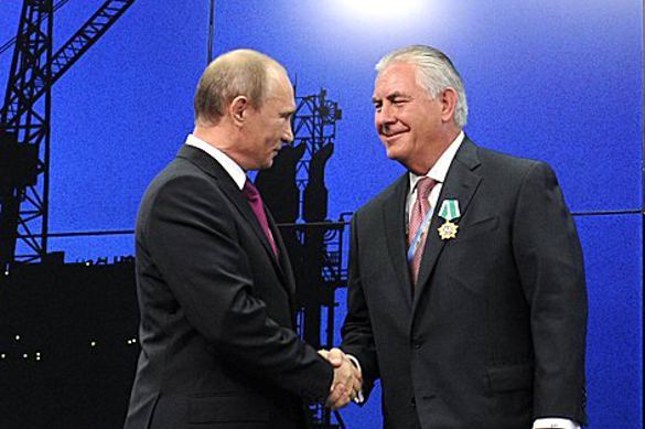 Vladimir_Putin_and_Rex_Tillerson_(2013-06-13)_(cropped)
