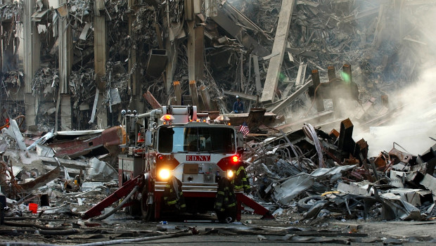 010916-N-7479T-501 Ground Zero, New York City, N.Y. (Sept. 16, 2001) -- A lone fire engine at the crime scene in Manhattan where the World Trade Center collapsed following the Sept. 11 terrorist attack.  Surrounding buildings were heavily damaged by the debris and massive force of the falling twin towers.  Clean-up efforts are expected to continue for months.  U.S. Navy photo by Chief Photographer's Mate Eric J. TIlford.  (RELEASED)