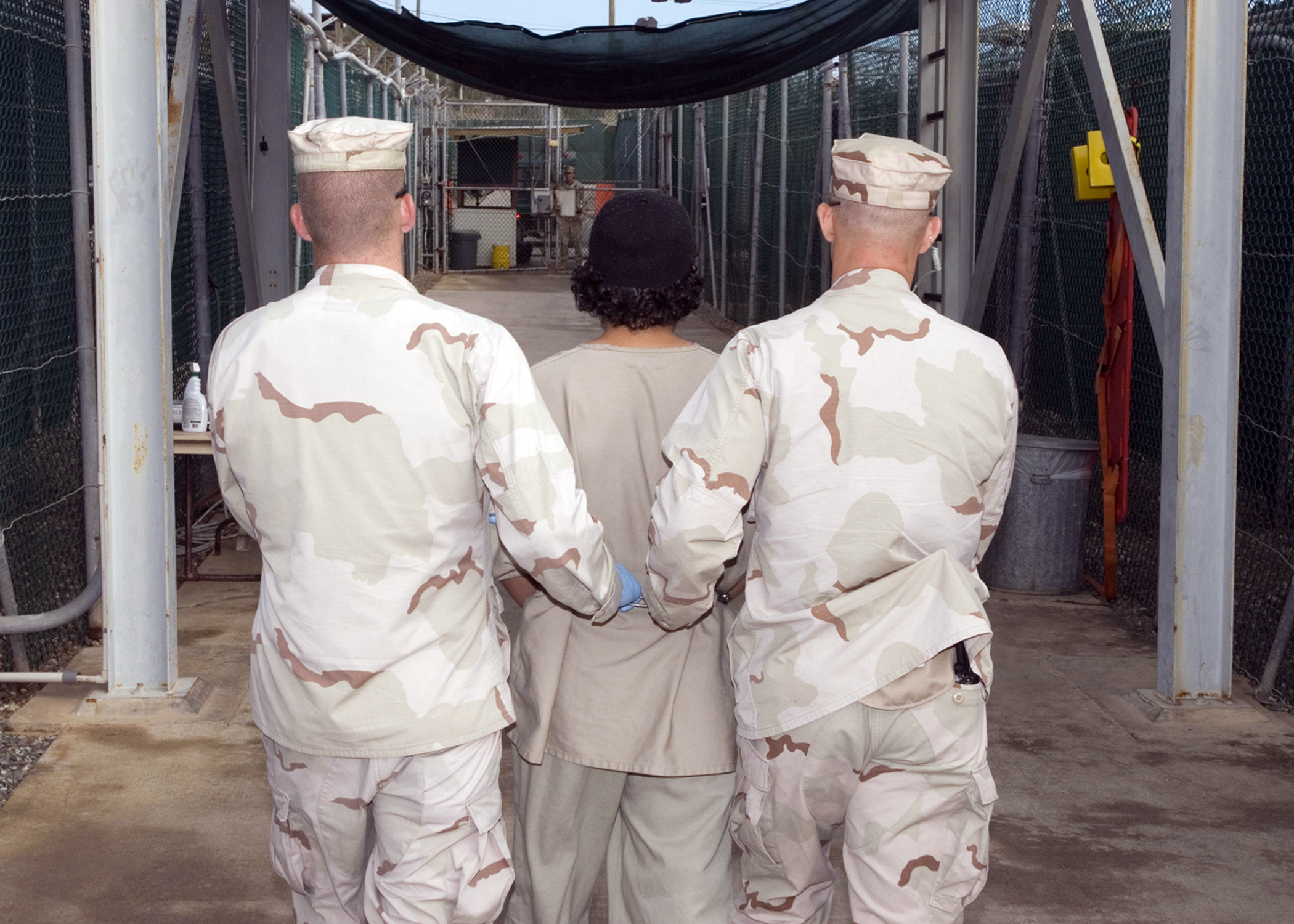 JTF Guard Force Troopers transport a detainee to the detainee hospital located adjacent to Camp Four, Dec. 27, 2007. The U.S. government?s program to transfer and release detainees is unprecedented during a time of war. JTF Guantanamo conducts safe and humane care and custody of detained enemy combatants. The JTF conducts interrogation operations to collect strategic intelligence in support of the Global War on Terror and supports law enforcement and war crimes investigations. JTF Guantanamo is committed to the safety and security of American service members and civilians working inside its detention facilities. (JTF Guantanamo photo by Navy Petty Officer 1st Class Michael Billings) UNCLASSIFIED. Cleared for public release. For additional information contact JTF Guantanamo PAO 011-5399-3596; DSN 660-3596.