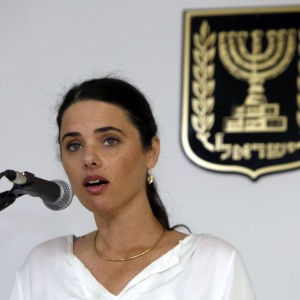 epa04752788 Israel's newly-appointed Justice Minister Ayelet Shaked smiles during a ceremony welcoming her at the Justice Ministry in Jerusalem, Israel, 17 May 2015. A nationalist in Bennett's Jewish Home party, Shaked is one of Israel's youngest ministers.  EPA/GALI TIBBON / POOL