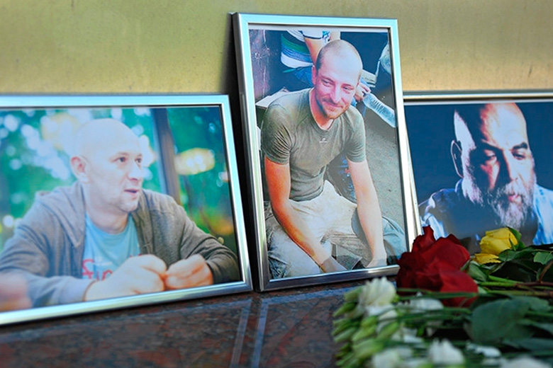 Photos of the three Russian journalists killed in the Central African Republic