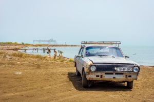 Old Soviet Volga car and abandoned oil rig on the shore of Caspian sea, Azerbaijan (Shutterstock)