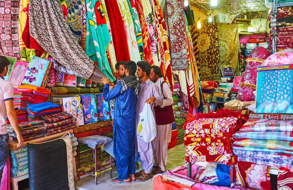 Baluchs at bazaar in Kerman, Iran (eFesenko via Shutterstock)