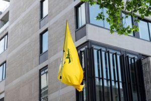 Hezbollah flag flying in London during Al-Quds Day rally in 2018 (Edward Crawford via Shutterstock)