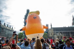 "Anti-Trump protesters float a giant ""baby Trump"" in London. (Shutterstock)"