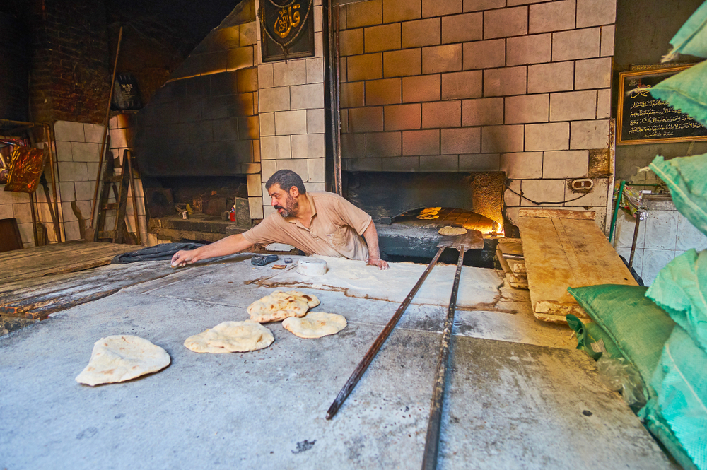 Making bread in Egypt (eFesenko via Shutterstock)