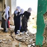 Students at their destroyed school in Taiz, Yemen (anasalhajj via Shutterstock)