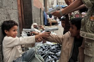 Children playing with toy guns on a street in Sanaa (Vladimir Melnik via Shutterstock)