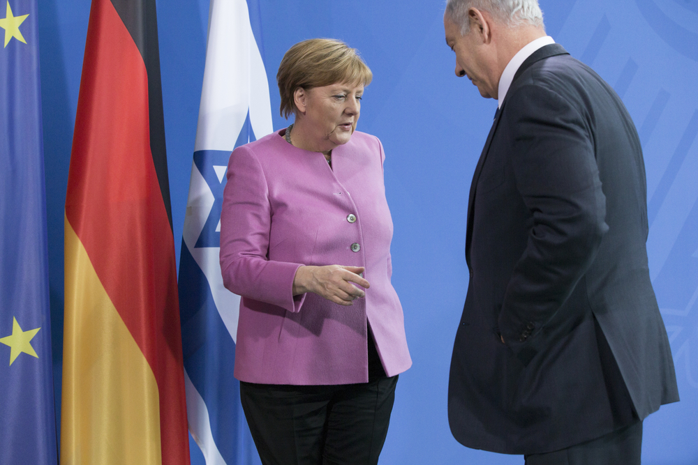 Angela Merkel and Benjamin Netanyahu (berlinpictures16 via Shutterstock)