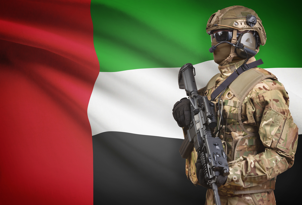 Soldier against backdrop of UAE flag (Shutterstock)